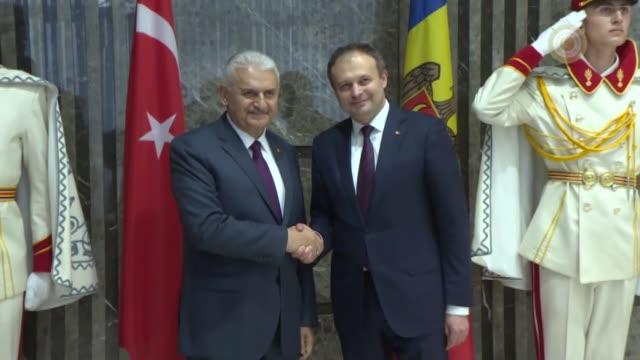 turkish prime minister binali yildirim meets with moldovan parliament speaker andrian candu in chisinau moldova on may 05 2017 17 - türkischer premierminister stock-videos und b-roll-filmmaterial