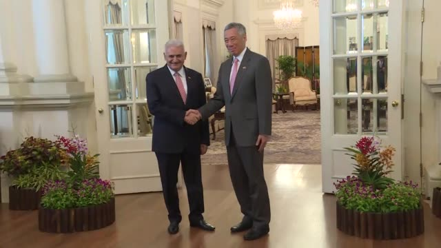 Turkish Prime Minister Binali Yildirim meets with Singapore's Prime Minister Lee Hsien Loong at the Istana Presidential Palace in Singapore on August...