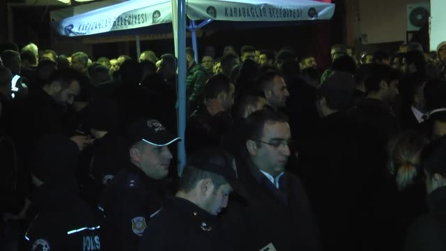 turkish prime minister binali yildirim pays a visit to relatives of police officer fethi sekin and officer of the court musa can who martyred as a... - binali yildirim stock-videos und b-roll-filmmaterial