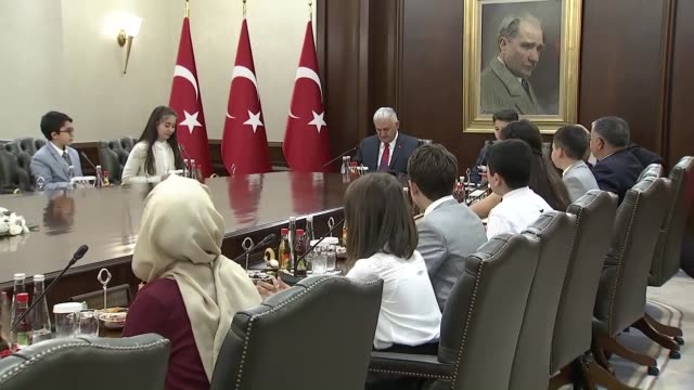 turkish prime minister binali yildirim receives a group of children at cankaya palace where they followed the annual tradition of taking the seats of... - türkischer premierminister stock-videos und b-roll-filmmaterial
