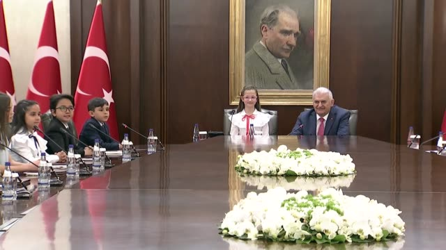 turkish prime minister binali yildirim receives a group of children accompanied by education minister ismet yilmaz at cankaya palace on national... - time of day stock videos and b-roll footage