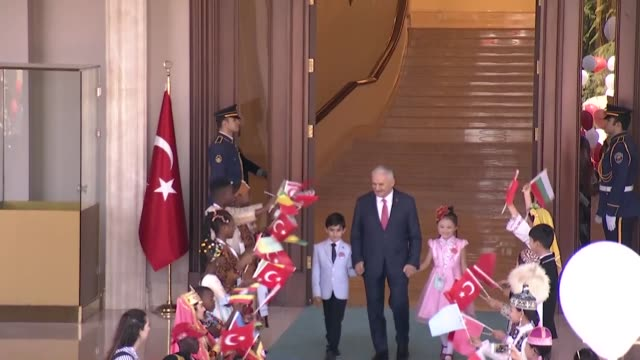 turkish prime minister binali yildirim receives a group of turkish and foreign children at cankaya palace on national sovereignty and children's day... - time of day stock videos and b-roll footage