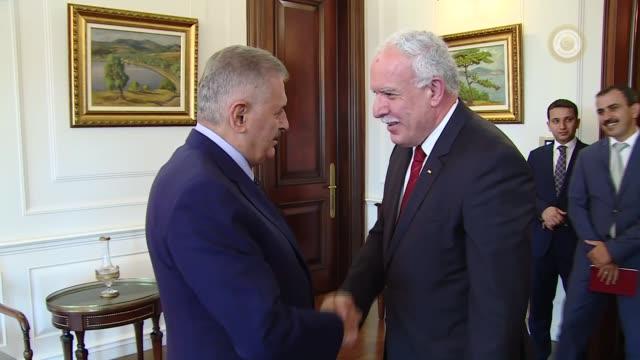 turkish prime minister binali yildirim receives palestinian foreign minister riyad al-maliki at the cankaya palace in ankara, turkey on august 11,... - トルコ首相点の映像素材/bロール