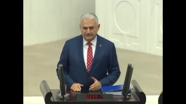 Turkish Prime Minister Binali Yildirim speaks at a debate over 2018 budget at the Grand National Assembly of Turkey in Ankara on December 11 2017...