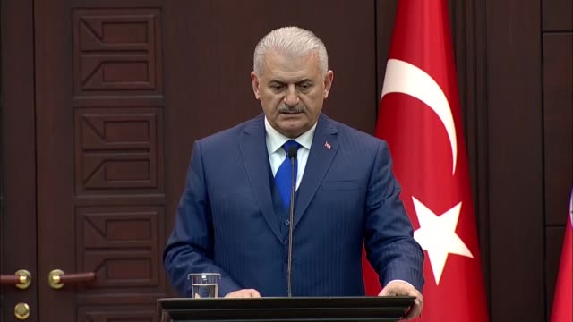 Turkish Prime Minister Binali Yildirim speaks at a joint press conference with his Lebanese counterpart Saad Hariri following their meeting at...