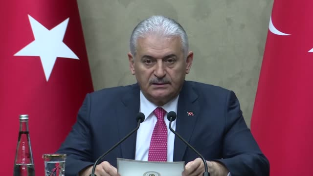 vídeos de stock, filmes e b-roll de turkish prime minister binali yildirim speaks at a news conference ahead of his visit to spain's capital madrid on april 24 2018 at esenboga airport... - embrace