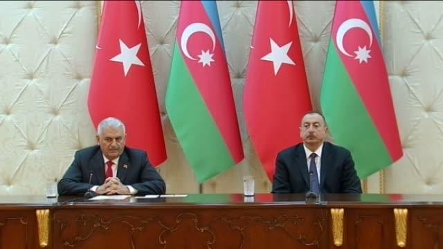 turkish prime minister binali yildirim speaks during a joint press conference with azerbaijani president ilham aliyev at zagulba presidential palace... - primo ministro turco video stock e b–roll