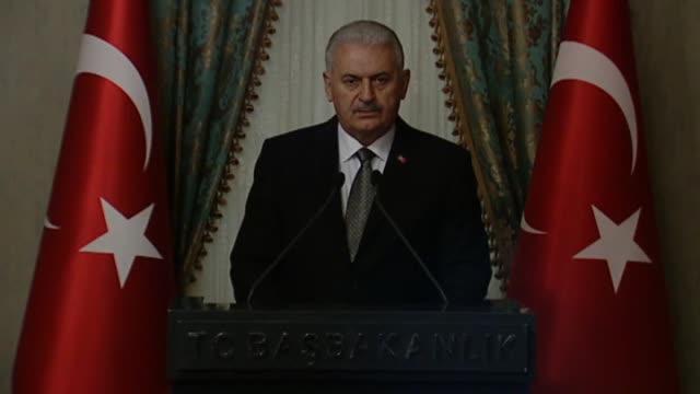 turkish prime minister binali yildirim speaks during a joint press conference with his georgian counterpart giorgi kvirikashvili following their... - binali yildirim stock-videos und b-roll-filmmaterial