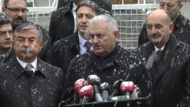 turkish prime minister binali yildirim speaks to media as he leaves sincan barbaros mosque after performing the friday prayer in ankara, turkey on... - primo ministro turco video stock e b–roll