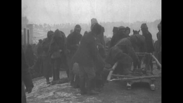 turkish prisoners of war march on snowy landscape after being captured by the russian caucasus army during the caucasus campaign of world war i / rca... - 牛車点の映像素材/bロール