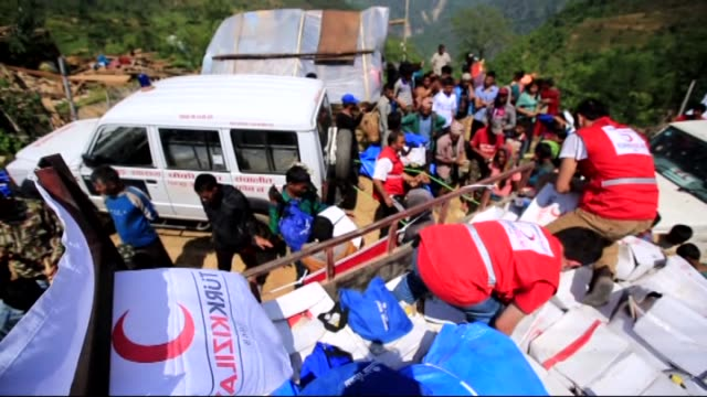 Turkish Red Crescent members deliver humanitarian aid packages containing food blankets and bottled clean water to the people affected by the...