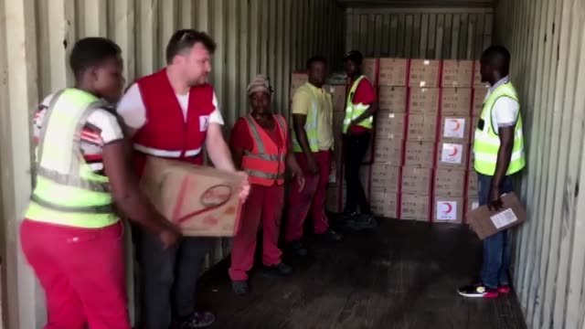 turkish red crescent members distribute aid to the needy people in mozambique's cyclone-hit beira city on march 22, 2019. interview with turkish red... - mozambique stock videos & royalty-free footage