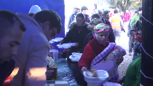 Turkish Red Crescent opens mobile kitchen to serve earthquake victims in Canakkale Turkey on February 09 2017 Turkish Red Crescent Operatives serve...