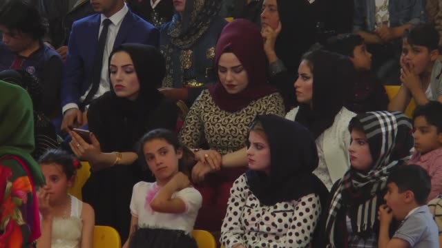 turkish red crescent, united arab emirates and barzani charitt foundation organize a mass wedding ceremony for refugees in arbil, iraq. 107 couples... - married stock videos & royalty-free footage