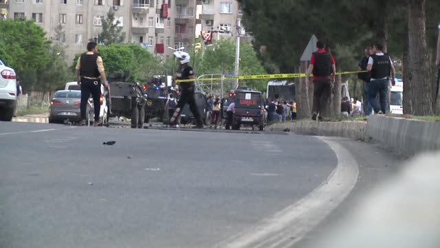 turkish security forces condon off attack scene and several ambulances were dispatched in diyarbakir's baglar district following a bomb attack... - terrorism stock videos & royalty-free footage