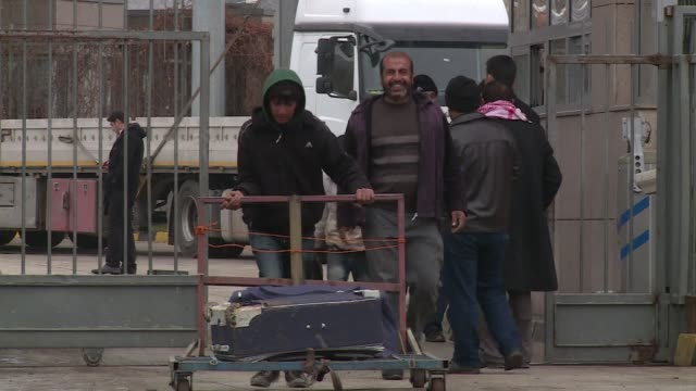 turkish security forces on sunday searched seven trucks near the syrian border suspected to be loaded with weapons and briefly detained three... - report stock videos & royalty-free footage