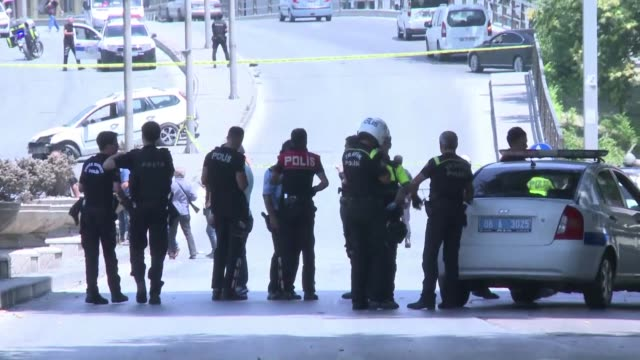 turkish security forces rush to the scene where a man allegedly carrying a weapon was shot by police at about one kilometre of the ankara court house... - kilometre stock videos & royalty-free footage