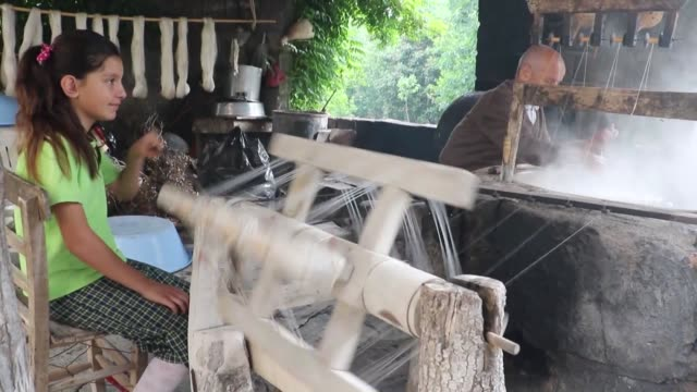 turkish sericulturist hasan buyukasik weaves silk in traditional way at manual loom in hatay turkey on may 16 2016 hasan buyukasik father of eight... - hatay stock videos & royalty-free footage