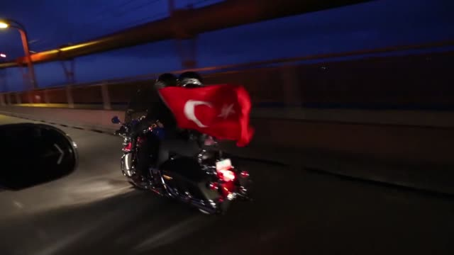turkish student ummuhan sen and freelancer of anadolu agency tayfun coskun protest july 15 coup attempt by riding on a harley davidson motorbike and... - golden gate bridge stock videos & royalty-free footage