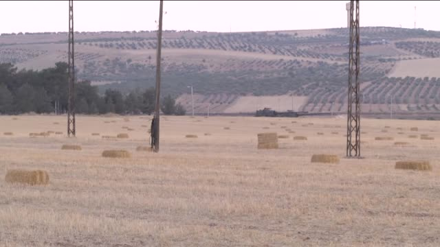 Turkish tanks and howitzers are deployed in Karkamis district of Gaziantep at Syria borderline for security after the clashes with Turkish soldiers...