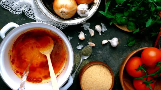 turkish tarhana soup - adding water - garlic stock videos & royalty-free footage