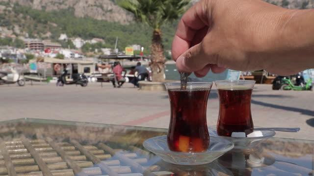 turkish tea in turunc, marmaris, anatolia, turkey - tee warmes getränk stock-videos und b-roll-filmmaterial
