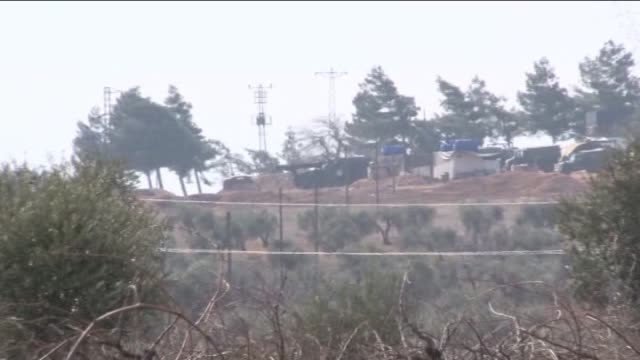 turkish troops shell positions of the pyd in syria's azaz district located in the northern countryside of aleppo just six kilometers from the turkish... - kurdistan workers party stock videos & royalty-free footage