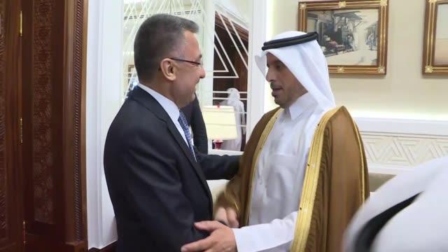turkish vice president fuat oktay meets with qatari prime minister and interior minister sheikh abdullah bin nasser bin khalifa al thani in doha,... - シャイフ点の映像素材/bロール
