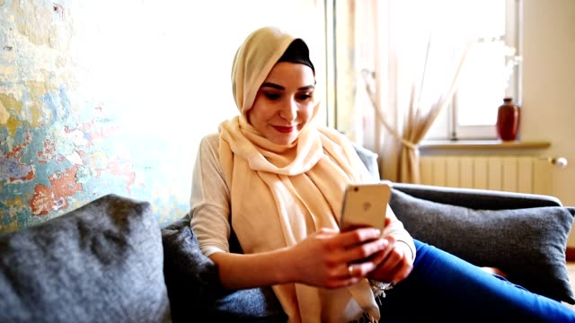 turkish woman with veil on the phone - turkish ethnicity stock videos & royalty-free footage