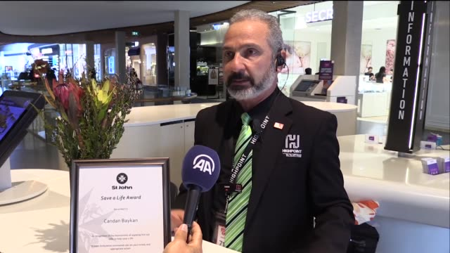 turkish-australian candan baykan who has been honored for saving the life of a 17-year-old boy, speaks in an interview on october 13, 2018 in... - security equipment stock videos & royalty-free footage