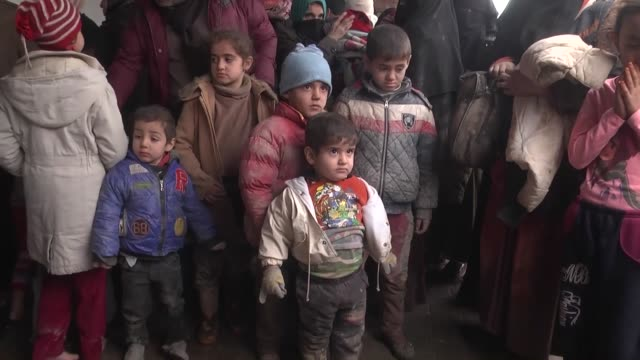 stockvideo's en b-roll-footage met turkmens mostly women and children who left their hometown of tal afar have reached turkey's border city of hatay on december 28 2016 after enduring... - bevroren