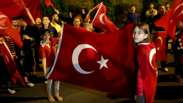 vídeos de stock, filmes e b-roll de turks gather outside the turkish embassy in skopje macedonia on july 15 2017 to commemorate the first anniversary of the defeated coup in turkey... - república da macedônia