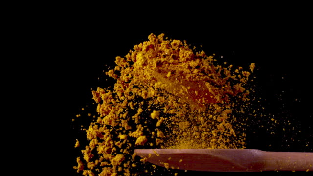 turmeric on a spoon in super slow motion 1000 fps - spice stock videos & royalty-free footage