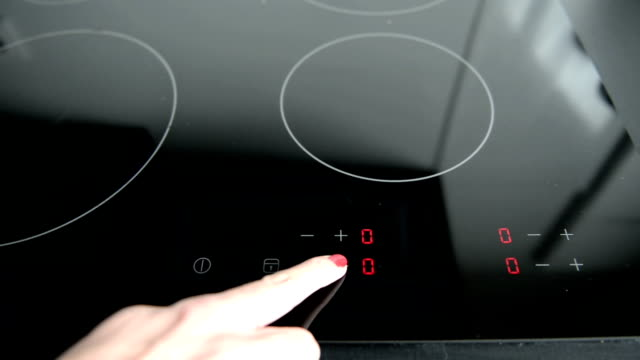 turn on a ceran stove - start button stock videos & royalty-free footage