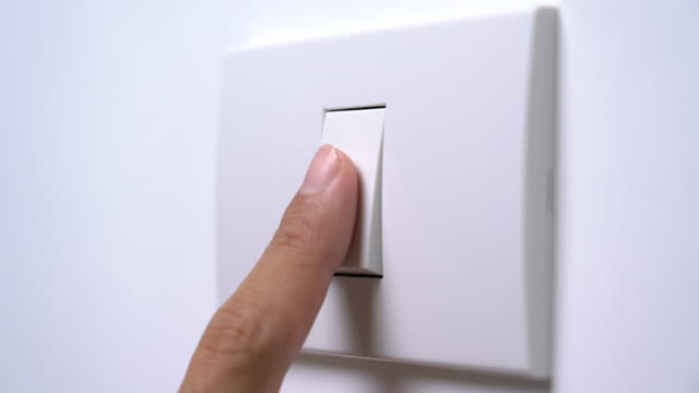 turn on and turn off a light switch - electric light stock videos & royalty-free footage