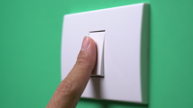 turn on and turn off a light switch - switch stock videos & royalty-free footage