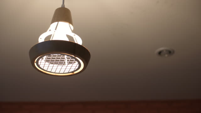 turn on light in ceiling - electric lamp stock videos & royalty-free footage