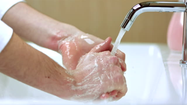 turned on the faucet - washing hands stock videos & royalty-free footage