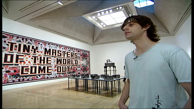 mark titchner and phil collins interviews; england: london: tate britain: int mark titchner interview sot - a mixture of fear and excitement, a... - philosophy stock videos & royalty-free footage