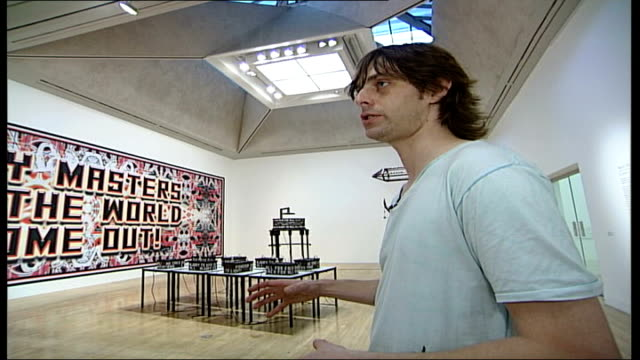 vídeos de stock, filmes e b-roll de mark titchner and phil collins interviews; - talks about installation / thinking about the ways we act in institutions / installation a bit like a a... - phil collins