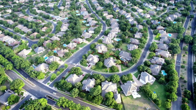 turning around above luxury homes in suburb  - aerial drone view - austin , texas - residential district stock videos & royalty-free footage