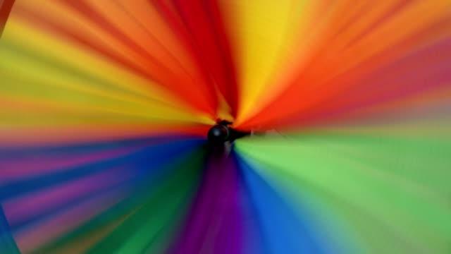 turning colorful wind wheel, germany - girandola video stock e b–roll