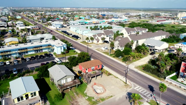 turning down long beach road padre island beach sand dunes and vacation rental homes - corpus christi texas stock videos & royalty-free footage