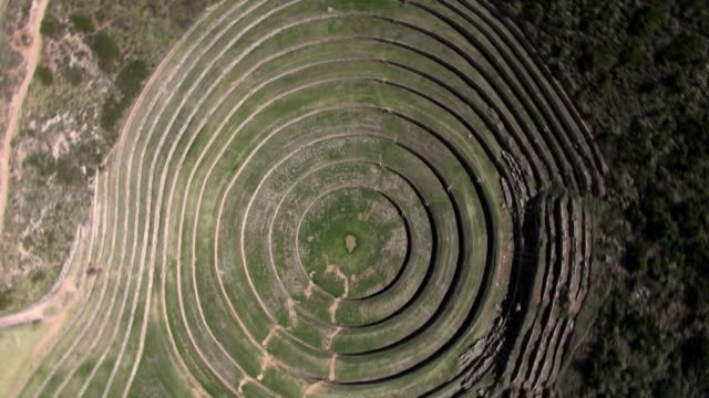 turning drone shot showing inca site moray - circle stock videos & royalty-free footage