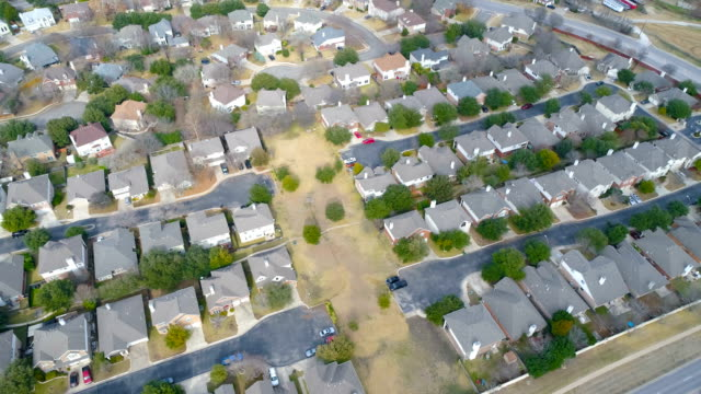 turning high above massive suburb neighborhood with modern layout pattern round rock , texas , aerial drone view rows and rows of houses with huge curved street around the entire community - modern rock stock videos & royalty-free footage