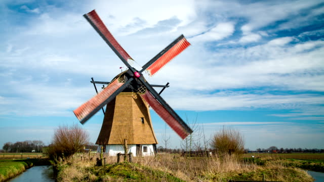 turning historic windmill in the netherlands - netherlands stock videos & royalty-free footage