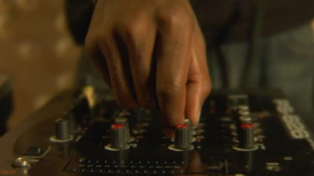 cu pan dj turning knobs on mixer/ los angeles, california - dj stock videos & royalty-free footage