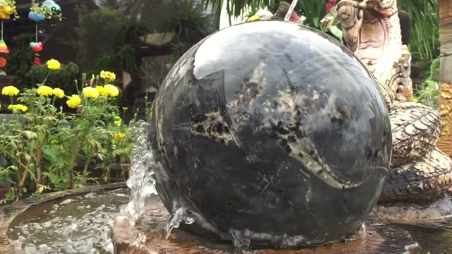 turning marble stone sphere on water - rock type stock videos and b-roll footage