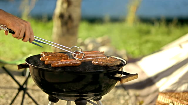 turning meat on barbecue - sausage stock videos & royalty-free footage