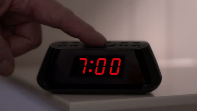 turning off a digital alarm clock, time from 6.59 to 7.00. man's hand. - number 7 stock videos & royalty-free footage